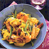 Curried Shrimp served in a blue bowl with vegetables