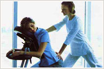 Our chiropractor gives a massage to a woman who is suffering from pain in her back