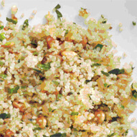 Quinoa Pilaf With Pine Nuts in a white plate